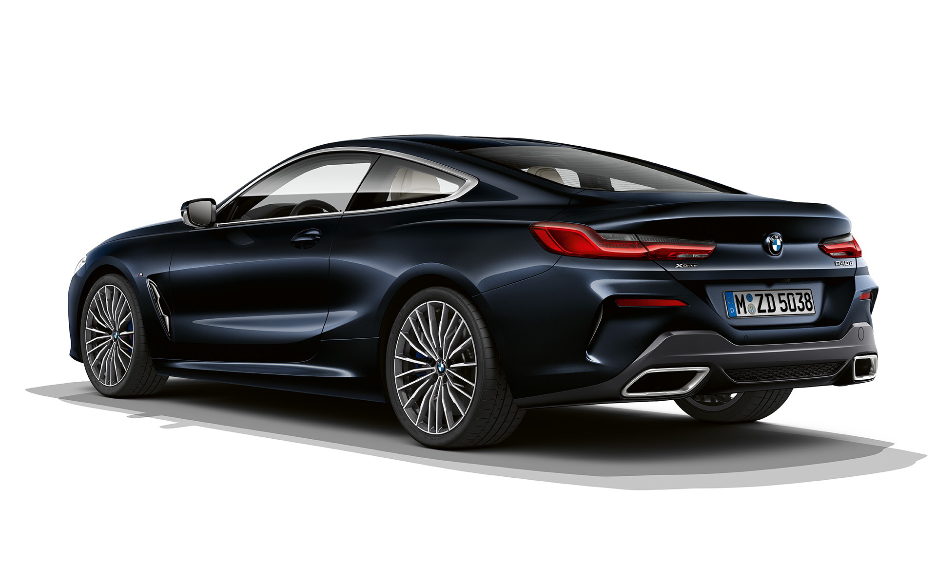 Still shot of the BMW 8 Series Coupé in carbon black metallic against a white background.