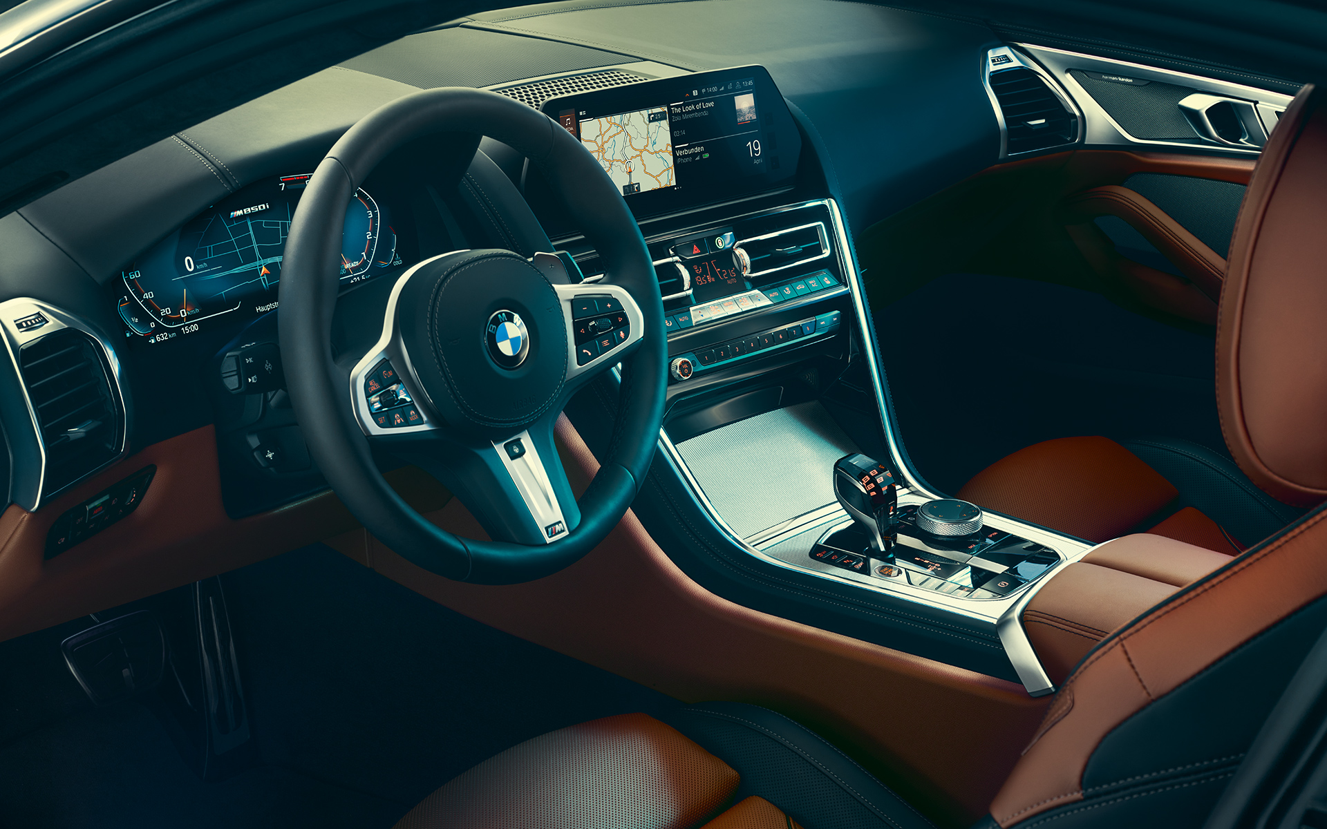 Interior of the BMW 8 Series Coupé, focused on steering wheel.